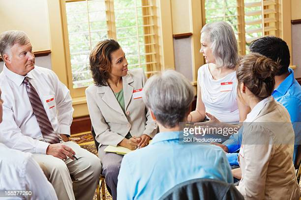 Diverse support group in serious discussion
