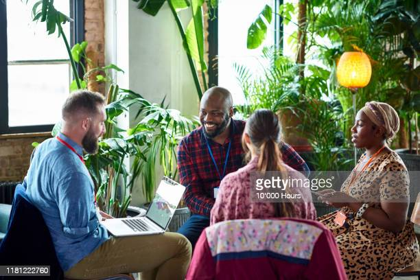 diverse team brainstorming in workshop - amputee woman stock pictures, royalty-free photos & images