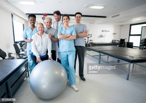 Diverse team of healthcare professionals and patients at a physical rehabilitation clinic