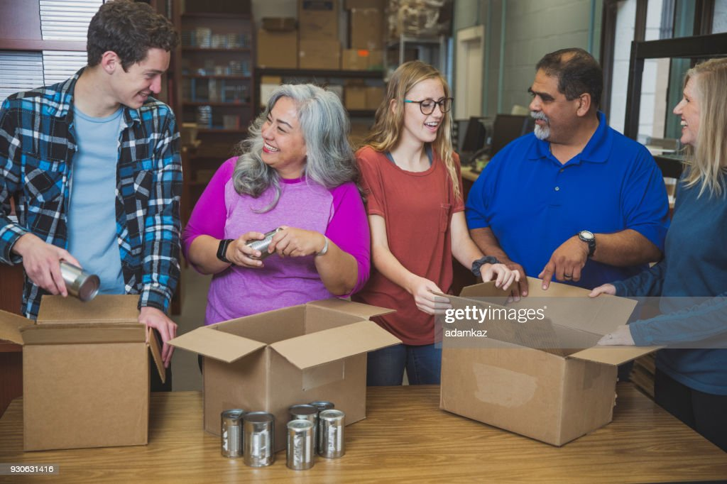 Diverse Team Volunteering Food Drive : Stock Photo