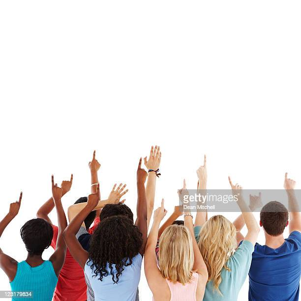 diverse teens pointing to the sky - isolated - op de rug gezien stockfoto's en -beelden