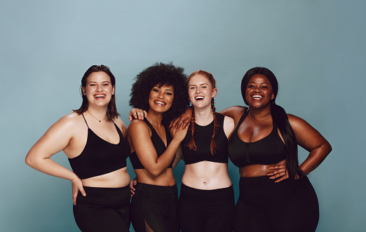 Diverse women embracing their natural bodies 1126087197