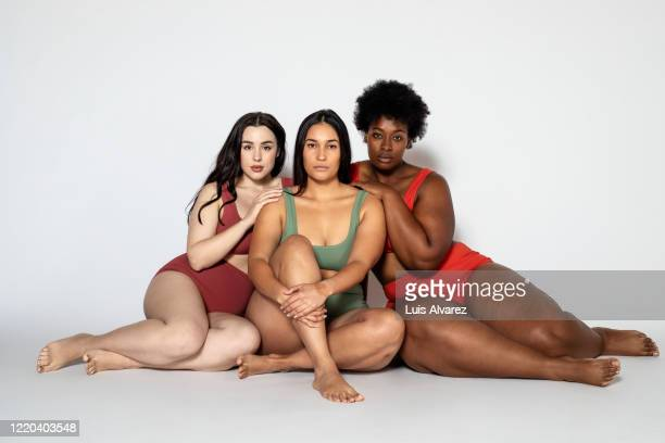 diverse women in underwear sitting together - body positive stock pictures, royalty-free photos & images