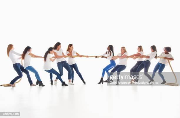 Diverse women playing tug-of-war