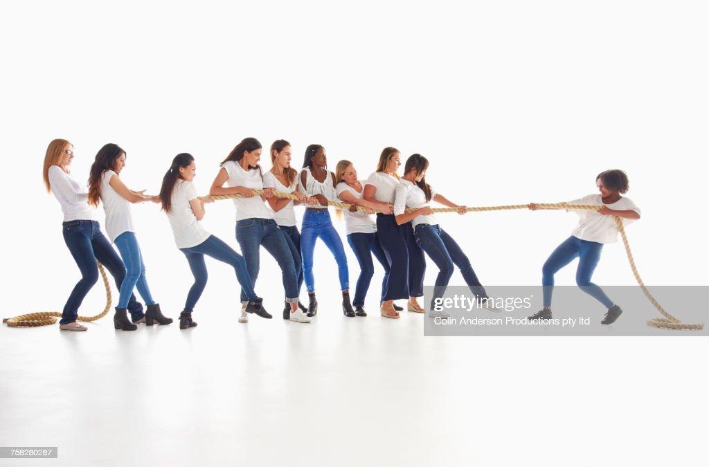 Diverse women playing tug-of-war : ストックフォト