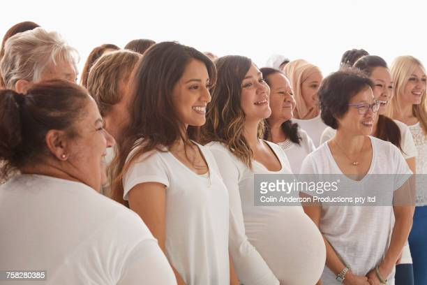 diverse women standing and smiling - diverse women - fotografias e filmes do acervo