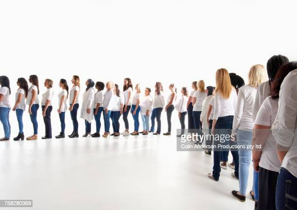 diverse women waiting in long line - lining up stock pictures, royalty-free photos & images