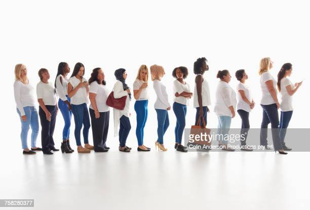 diverse women waiting in long line - multiculturalism stock pictures, royalty-free photos & images