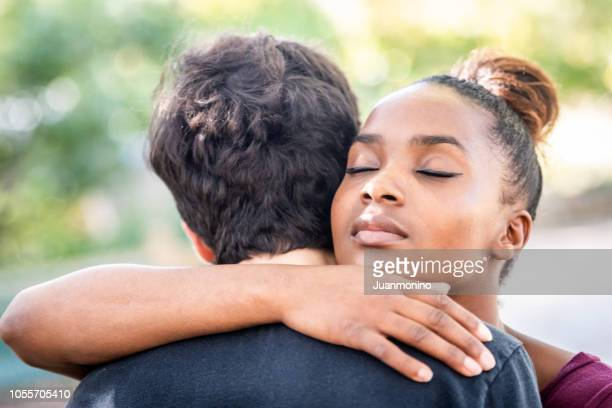 diverse young couple, they are embracing - i love you stock pictures, royalty-free photos & images