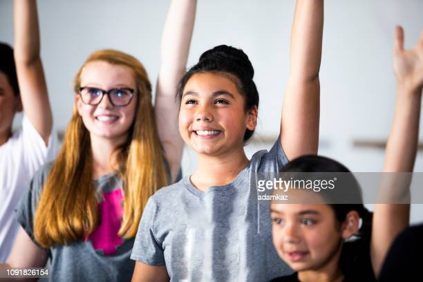 diverse young students practicing musical theatre dance in studio - arte, cultura e espetáculo imagens e fotografias de stock