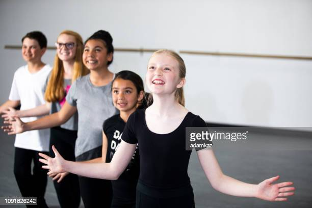 diverse young students practicing musical theatre dance in studio - musical theater stock pictures, royalty-free photos & images