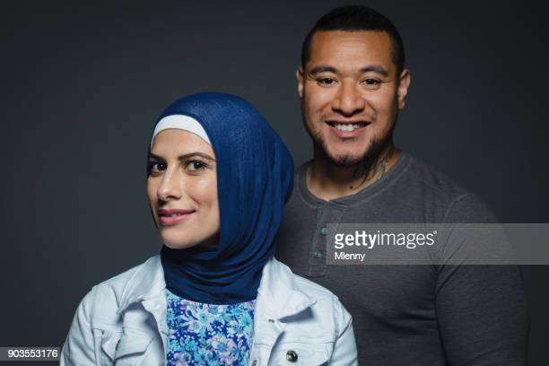 Diversity Portrait Pacific Islander Maori Man and Middle Eastern Muslim Woman