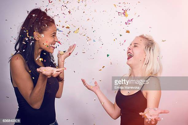 Diversity - Two girls dancing and smiling with flying confetti