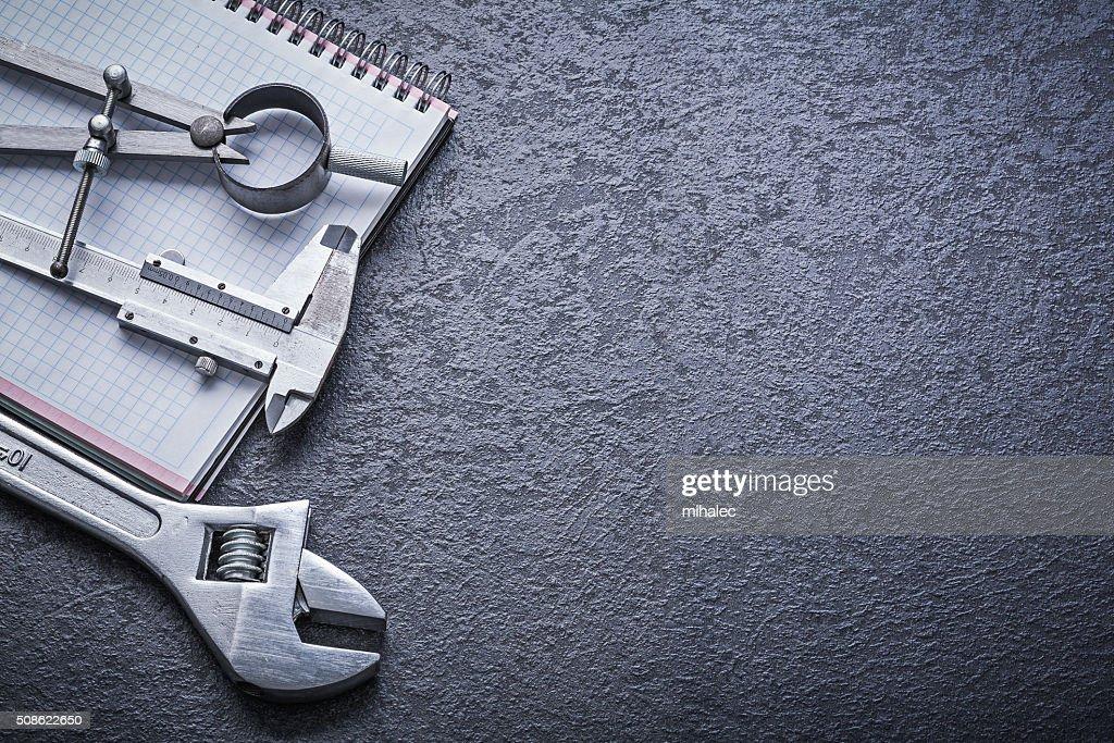 Divider calliper adjustable spanner notebook construction concep : Stock Photo