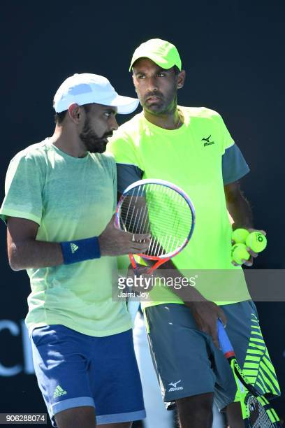 Divij Sharan of India and Rajeev Ram of the United States compete in their first round men's doubles match against Marius Copil of Romania and Viktor...