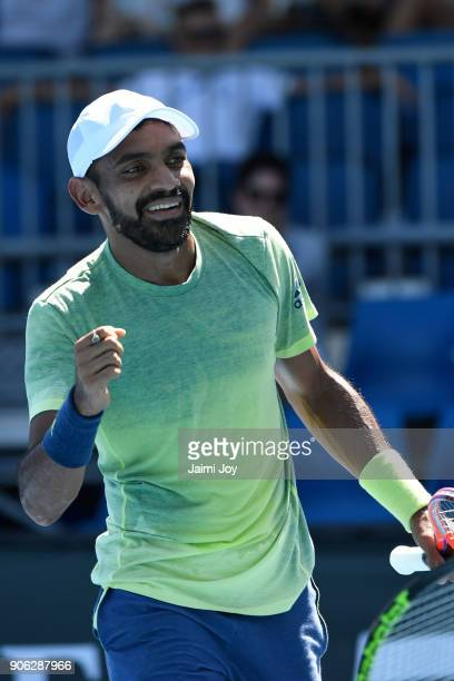 Divij Sharan of India reacts in his first round men's doubles match with Rajeev Ram of the United States against Marius Copil of Romania and Viktor...