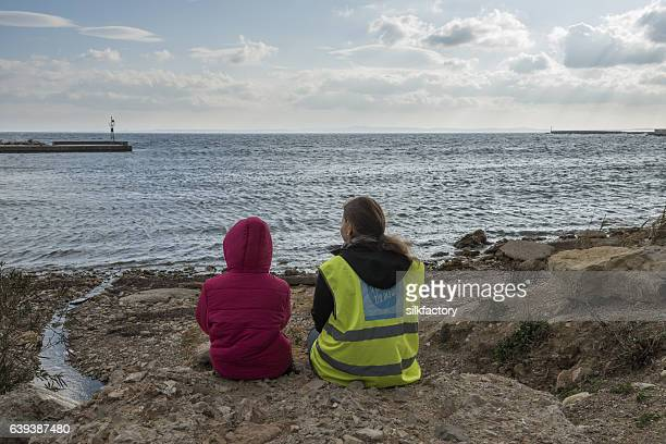 divine light over greek refugee camp at christmas - refugee camp stock pictures, royalty-free photos & images