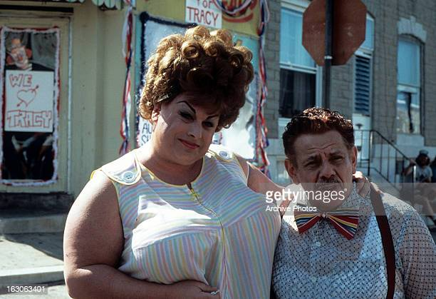 Divine stands next to Jerry Stiller in a scene from the film 'Hairspray' 1988
