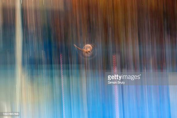 2012 Summer Olympics Slow shutter blur of diver in action during Men's 10M Platform Semifinals at Aquatics Centre London United Kingdom 8/11/2012...