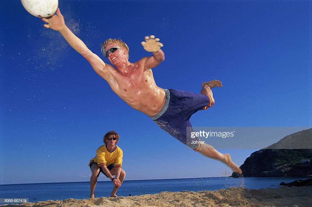 Diving Beach Volleyball Player : Stock Photo