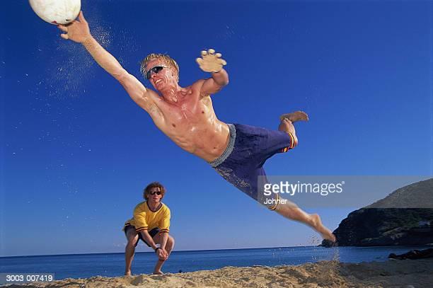 Diving Beach Volleyball Player