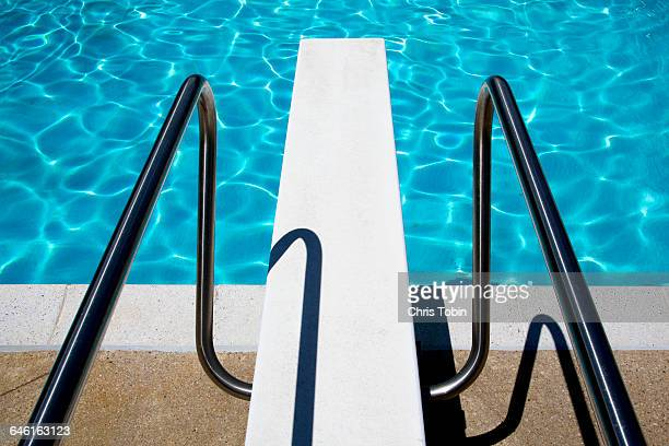 Diving board at swimming pool