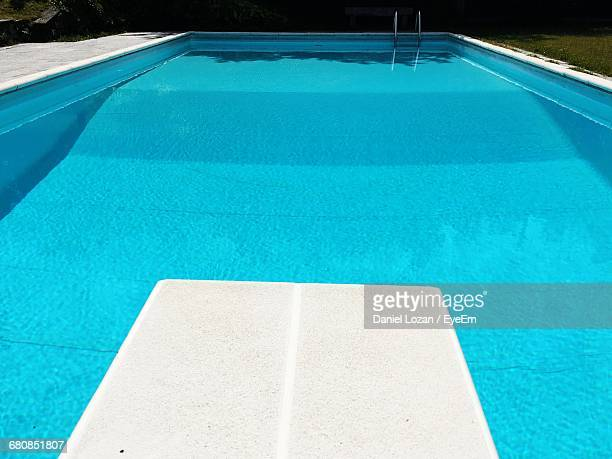 Diving Board By Blue Swimming Pool