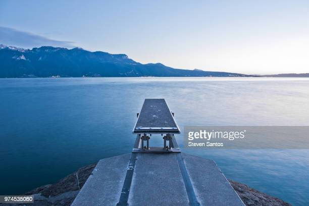 diving board by lake, st. saphoring, switzerland - diving board stock pictures, royalty-free photos & images