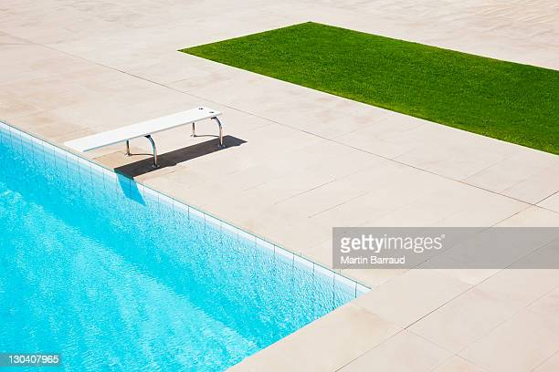 diving board over pool - poolside stock pictures, royalty-free photos & images