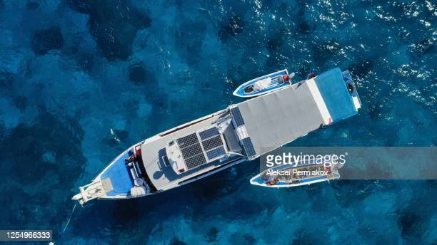 diving boat at the blue water lagoon - 旅客船 ストックフォトと画像