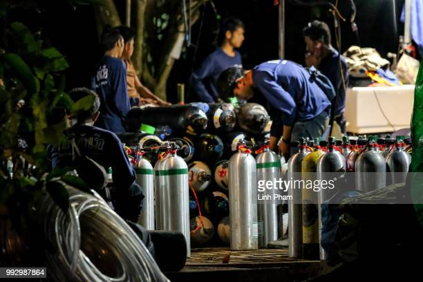 Diving cylinders are prepared at a makeshift camp at the entrance of Tham Luang Nang Non caves for the divers to continue the rescue operation for...