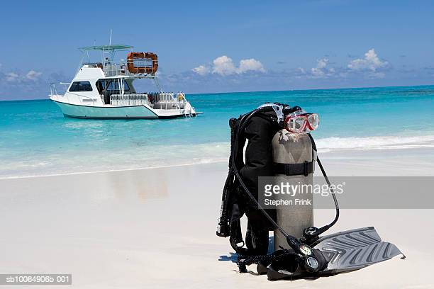 diving equipment on beach and speedboat - aqualung diving equipment stock pictures, royalty-free photos & images
