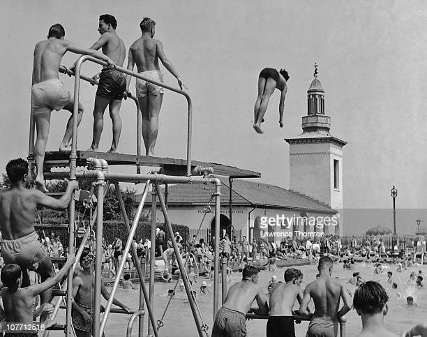 Diving in to the swimming pool at Playland in Rye Beach New York circa 1950's
