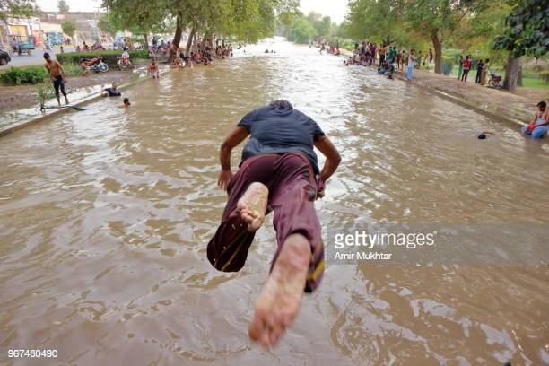 diving into canal - amir mukhtar stock photos and pictures