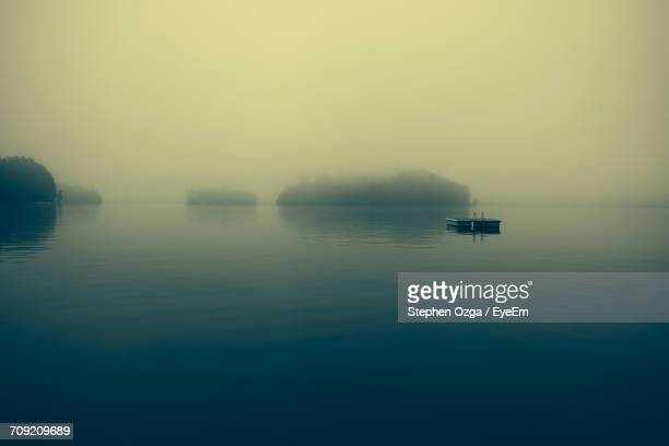 diving platform in lake during foggy weather - diving platform stock pictures, royalty-free photos & images