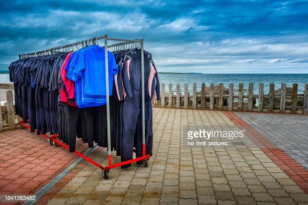 diving suits drying outdoors
