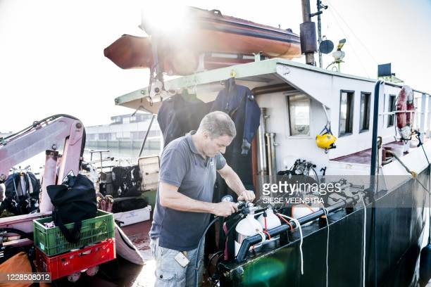 Diving team get ready for a cleaning action in the North Sea organised by the Duik De Noordzee Schoon foundation in Lauwersoog, the Netherlands, on...
