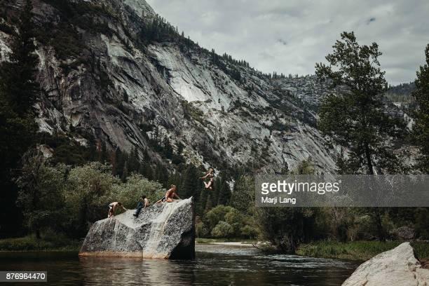Diving youth at Mirror Lake in Yosemite National Park, USA.
