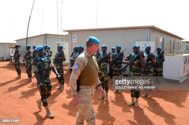 Division General JeanPaul Deconinck of the Belgian Army reviews UN troops as he arrives in Gao on April 13 2017 to take command of the MINUSMA / AFP...