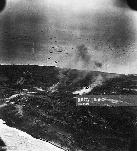 A division of F6F's from carriers of Task Force 58 of Marines on Iwo Jima in the Volcano Islands on D2day US fleet in background