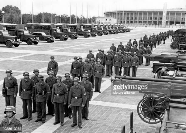 Division of the Security and Assistance Service takes part in an exercise outside of the Olympic Stadium in Berlin, Germany, July 1940. Photo:...