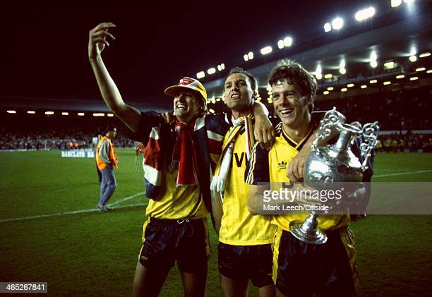 Division One Championship Decider Liverpool v Arsenal David O'Leary Steve Bould and Tony Adams celebrate with the championship trophy