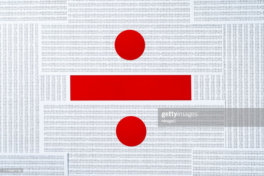Division Sign Made of Data Sheets Pile : Stock Photo