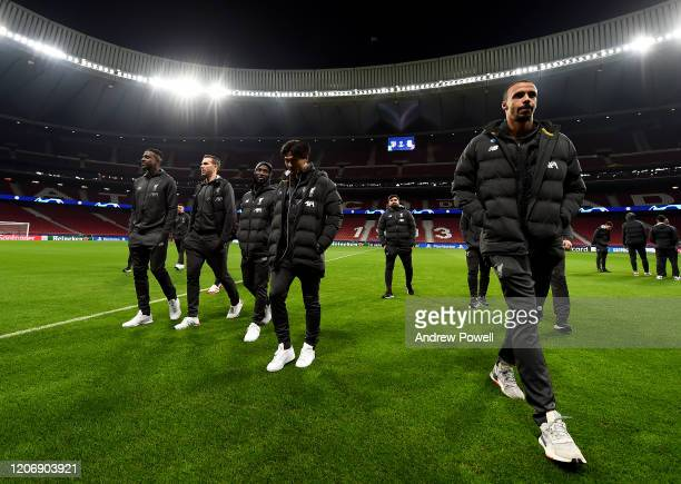 Divock Origi Adrian Naby Keita Takumi Minamino and Joel Matip of Liverpool having a walk around the pitch during a press conference at Wanda...