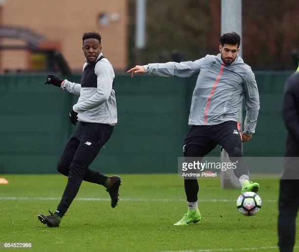 Divock Origi and Emre Can of Liverpool during a training session at Melwood Training Ground on March 17 2017 in Liverpool England
