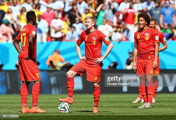 Divock Origi and Kevin De Bruyne of Belgium wait to kickoff after allowing Argentina's first goal during the 2014 FIFA World Cup Brazil Quarter Final...