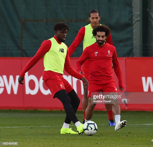 Divock Origi and Mohamed Salah of Liverpool during a training session at Melwood Training Ground on October 18 2018 in Liverpool England