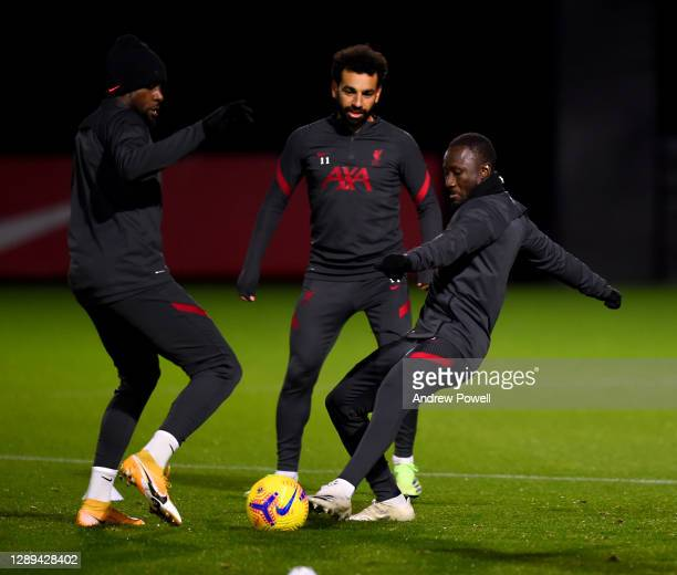 Divock Origi and Naby Keita of Liverpool during a training session at AXA Training Centre on December 04, 2020 in Kirkby, England.