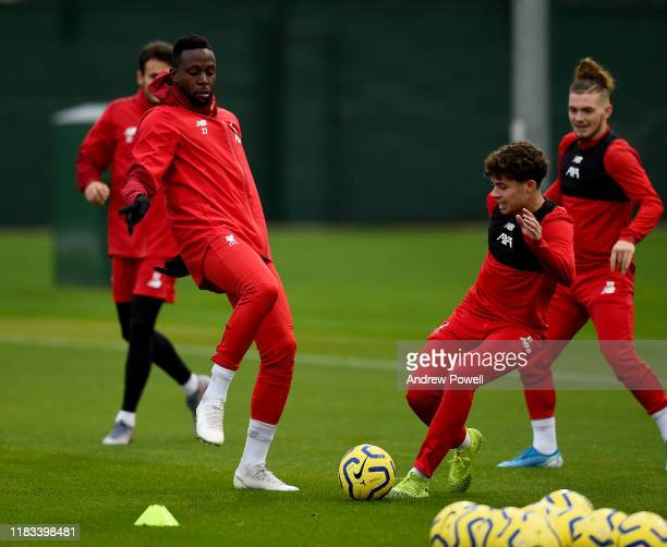 Divock Origi and Neco Williams of Liverpool during a training session at Melwood Training Ground on October 25 2019 in Liverpool England