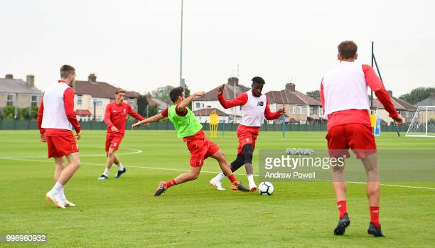Divock Origi and Pedro Chirivella of Liverpool during a training session at Melwood Training Ground on July 12 2018 in Liverpool England